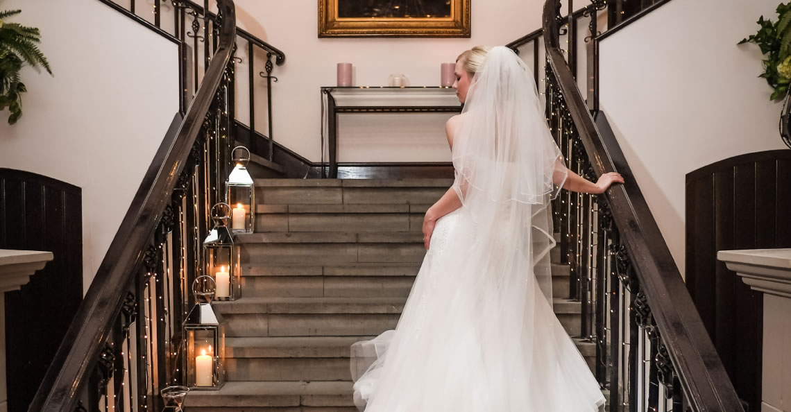 Grand Entrance: Our dramatic staircase leads into the magnificent ballroom